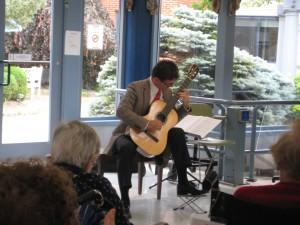 Peter Fletcher, classical guitarist, performing at Morris View