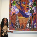 Bisa Butler in front of her large quilt