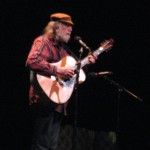 Folksinger Mike Agranoff performs