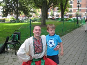 Dancer Sergij Tsyghanok with young audience member