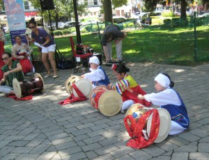 Young drummers learn Korean traditional patterns