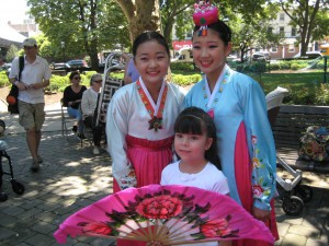 Young fan of the Fan Dance with two dancers