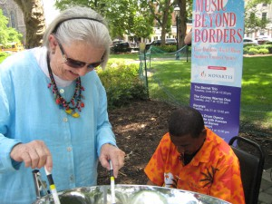 Mary Louise Smith tries her hand at the steel pan