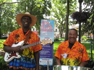 Conroy Warren and Patrick Gomes with Music Beyond Borders banner