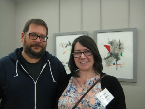 Artist Christine Wagner (R) with her husband, in front of her works
