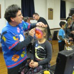 Christopher Agostino, expert face painter at work