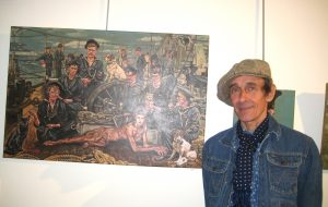 Artist Nicholas Gamarello with his work