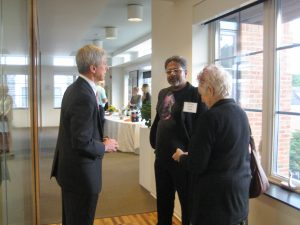 Dodge Foundation CEO Chris Daggett talking with artist Sunil Garg and his wife Michelle