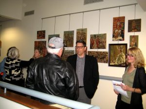 Attendees admiring the art