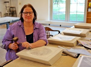 Master stone carver Gabrielle Hiltl-Cohen at work