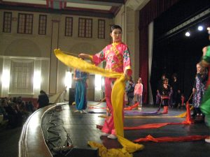 Nai Ni Chen dancers teaching the Ribbon Dance to young audience members