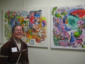 Artist Marsha Solomon with some of her works