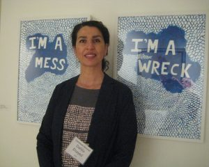 Artist Dahlia Elsayed in front of her work