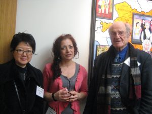 Artists Heejung Kim and Mel Leipzig flank curator Jeanne Brasile