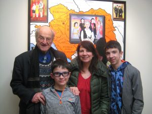 Artist Mel Leipzig with his daughter and grandsons in front of his painting