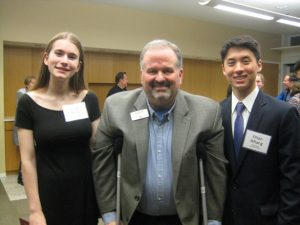Scholarship winners Lila Dunn and Ethan Whang flank Tom Werder, Executive Director for Morris Arts