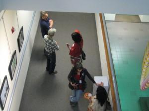 enjoying the art, people talking with artist John Tetz