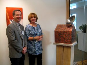 Sculptor Michael Wolf with the Dodge Foundation's Elaine Rastocky and Wolf's work, Portent